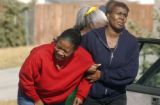 Macoya Harris (cq) (red) reacts after learning that the body of her aunt was discovered at the...