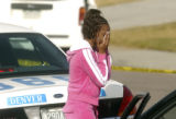An unidentified niece of the victim leaves the homicide scene at 5280 N. Altura  Street in ...