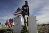 Earl Beelman (cq)  with the Sons of Confederate Veterans, walks through Riverside Cemetery,...