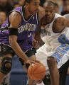 Nuggets center Marcus Camby, right, applies defensive pressure to Kings forward Shareef Abdur...