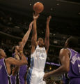 Nuggets guard Andre Miller shoots over Sacramento Kings defenders as the Denver Nuggets trailed...