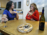 Brighton, CO Nov. 9, 2005 Maria Watts, 41,(left)  and Jennifer Kelley, 43 enjoy wine and snacks...