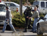 Members of the Jefferson County Bomb Squad during a bomb scare on Thursday morning November 10,...