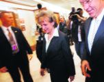 DCHG106 - Supreme Court Justice nominee Harriet Miers, center, walks down the hall with Sen. Wayne...