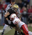 Nebraska's Cortney Grixby tackles CU's Dusty Sprague in second half action at Folsom field....