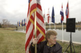 Dee Espinoza, (cq) VFW 322 Ladies Auxilliary, Englewood, Colo., places the american flag ahead of...