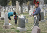 (Denver, Colorado, 11/11/2005) Matthew Lemming (cq), 3, listens while his mother Kathy Lemming...
