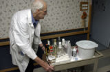 Marty Slatery, (cq), 70, pushes the hospitality cart down the halls of the Hospice of Saint John...