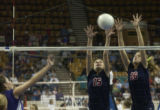(Lt. to rt.) Littleton High School's Kendall Wyatt number 7, is blocked by Chaparral High School's...