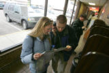 Amy Bates, 26, left, looks at a map while her husband Andrew Bates, 21, both of Manhattan, KS,...