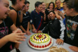Members of Grupo Folklorico Infantil present a cake to troupe director Ramiro Loera in honor of...