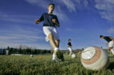 Twelve year-old Colorado Rush player Jimmy Shannon (cq) of Denver practices with fellow Rush...