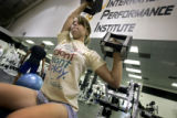 Isabelle Lindel (cq), 14, of Sarasota, Fla. lifts weights during a morning workout session in the...
