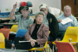 Denver, CO Nov. 14, 2005 Lena Archuleta of Denver (foreground) and other seniors listen to Euvaldo...