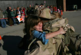 Jorydyn Renholm, cq, 7, left, and her brother Justin Renholm, cq, 8, right, rejoice as they hug...