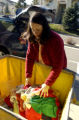 (DENVER, Colo., Nov. 16, 2005) Denver resident Joanna Reynolds (cq), drops off kids clothing at...