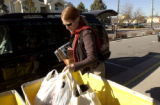(DENVER, Colo., Nov. 16, 2005) Denver resident Melanie Backes (cq), drops off goods at the...