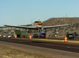 Pilot Jason Sosebee (cq) takes off south bound I-25 Wednesday afternoon November 16, 2005, south...