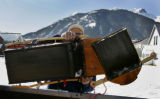 Brice Hoskin (cq) loads a sled after sledding down 10th Street   in Silverton, Colorado Wednesday...