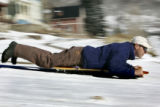 Brice Hoskin (cq) sleds down 10th Street   in Silverton, Colorado Wednesday November 16, 2005 on...