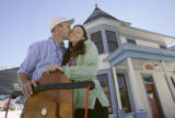 Brice Hoskin (cq)and his wife Karen stand in front of their Victorian home headquarters in...