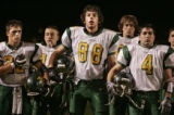Griffin Rasel (cq, #88), and his Mountain Vista High School teammates stand at attention as the...