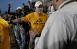 John Watson (cq), 20, left, a junior at the University of Colorado argues with stadium officials...