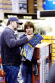 (DENVER., Colo., Nov. 26, 2005) Robert Smith and his wife Tina looks through a Best Buy handout as...