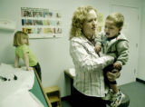 **Season to Share*  Denver, CO Nov. 17, 2005 Physician's assistant Deborah Chapman holds...