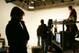 Oscar-winning documentary filmmaker Donna Dewey (cq), left, watches a tv monitor as her business...