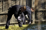 (DENVER, Colo., Nov. 18, 2005) Aurora police make holes in the ground in the backyard of...