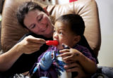 Cora Will (cq) comforts her 1 1/2 year old son Ty with a popsicle in the intensive care unit at...