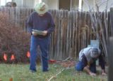 L to R: Clark Davenport (cq) and Jim Reed (cq) of NecroSearch plot out a grid to use for ground...