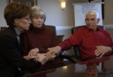 LEFT TO RIGHT: Diane Vertovec (cq),a niece,  joins hands with Agnes Rose Koldeway (cq), (center), ...