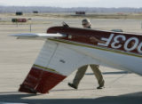 Jefferson County Airport controller Ross Bellows (cq) inspects a Piper Cherokee aircraft  Monday...