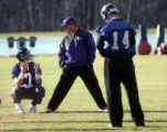 **SPECIAL FOR THE ROCKY MOUNTAIN NEWS**Baltimore Ravens quarterback coach Rick Neuheisel, center,...