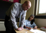Teacher Jeff Desserich (cq) talks to 8th grade student Alma Rocha during a math class Tuesday...