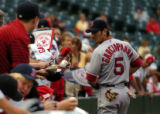 (DENVER, COLO., JUNE 15, 2004)   Boston Red Sox #5, Nomar Garciaparra signs autographs for Red Sox...