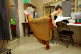 Kitty Hilsabeck, cq, practices part of her routine while being fitted for a costume during a break...