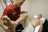Clint Wilson (cq, right), 18, of Edwards, Co. goes through a body mapping session with physical...