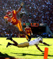 105087.SP.1203.trojans1.WJS  USC tailback Reggie Bush is upended by UCLA conerback Marcus Cassel...
