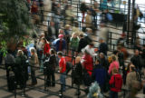 Lines of travelers at Denver International Airport waiting to get through security moved along...