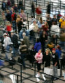 Lines of travelers at Denver International Airport waiting to get through security move along...