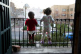 Dayshone Sylvester, 1, cq, left, and Kaelyn Elzy, 3, cq,  look at the neighborhood from the...
