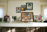 The living room mantle of Gloria Huff (cq), Lynette Thompson's (cq) biological mother, displaying...