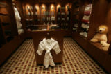 0298 A bath robe for a child hangs in the gift shop primarily carrying items from the Ritz Carlton...