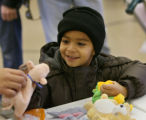 Gustavo Ramirez is all smiles as he looks for a stuffed animal, Friday morning, December 21, 2007,...