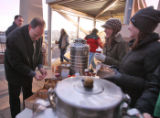 Coffee, orange juice, and  scones were served to light rail commuters by Union Pacific at the...
