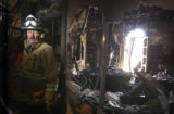 Golden Fire Chief John Bales inspects the fire damage of the central area of the second floor of...