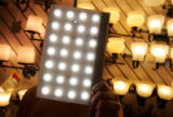 Don Peterson, a salesperson with Foothills Lighting holds a LED under cabinet lighting panel at...